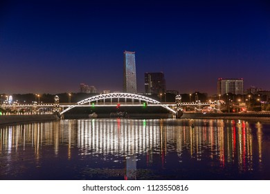 The lights of the bridge are reflected in the river. Morning Twilight