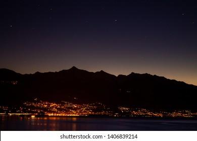 The lights of the city of Locarno over the lago Maggiore.