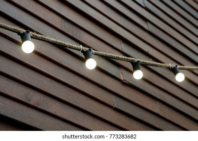 lights design lamp on the rope ,wood background