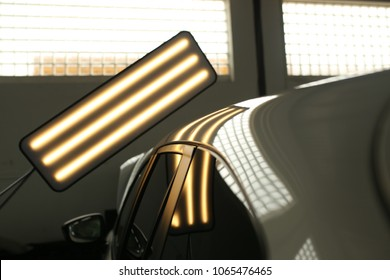 lights for detecting dents in a car body