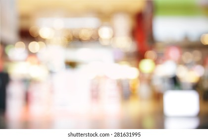 Lights of duty free shop in airport - defocused background