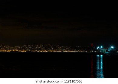 The lights of the night Haifa are visible from the shores of Acre