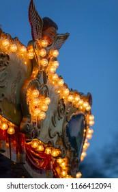 Lights on carousel on tivoli in Paris