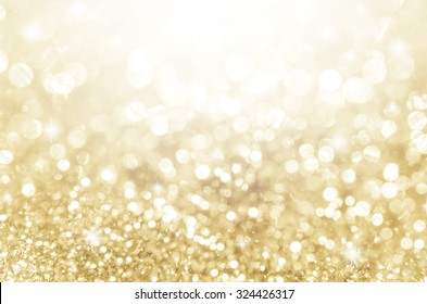Lights on gold with star bokeh abstract as background.