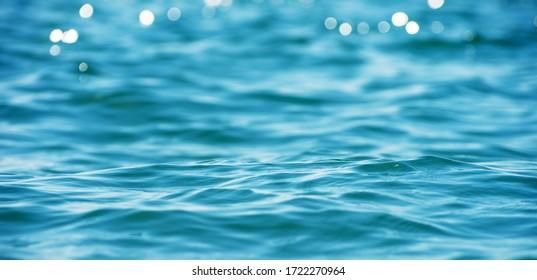 Lights on sea background. Waves.