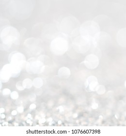 Lights on white silver background abstract beautiful blink light with bokeh bright winter and christmas decoration. Design blur backdrop luxury