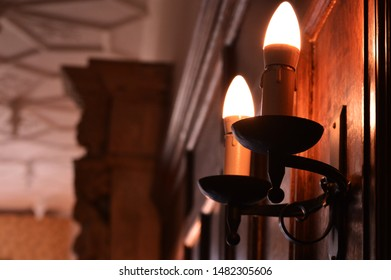 Lights on a wooden panel wall