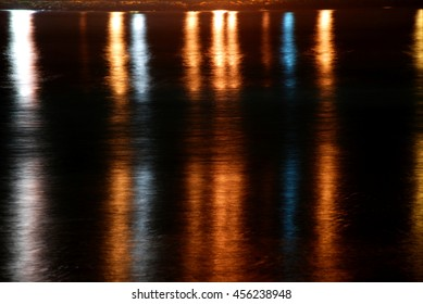 Lights reflected in the sea. Barbate, Cadiz, Andalucia, Spain.