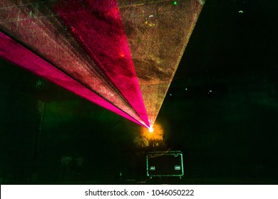 Lights show. Laser show. Night club dj party people enjoy of music dancing sound with colorful light. Club night light dj party club. With Smoke Machine and lights. Bright Performance laser Light show