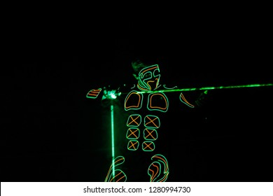 Lights show. Lazer show. Man is dancing with lazer