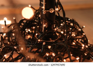 Lights tangled around an oboe musical instrument