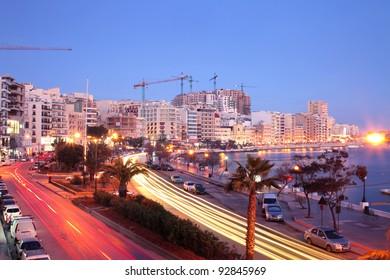 Lights of traffic on a street of Malta at night