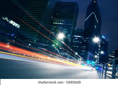 lights trails from cars in business centre-4