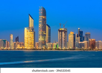 Lights Turning On in Abu Dhabi City sunset skyline