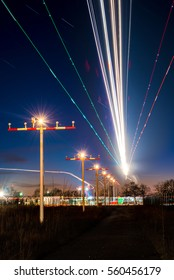 Light-trails of approaching aircraft during the evening rush at Frankfurt / Germany.