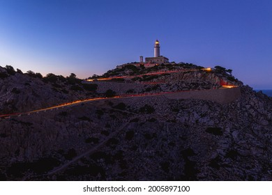 Lighttrails from cars at the Cap the Formentor during the blue hour.