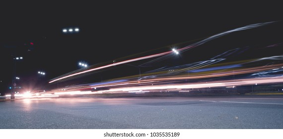 Lighttrails from cars and trucks in the road at night.