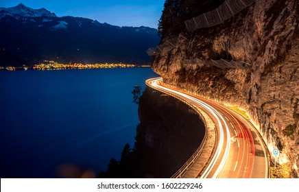 lighttrails of a s-curved street along Lake Thun during the Blue hour