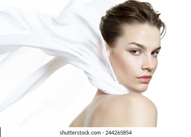 Lightweight beauty visual with a caucasian model wearing a white silk scarf.