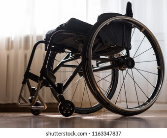 Lightweight and compact wheelchair for travel, sports and active life - a great helper for people with disabilities to have a leg injury after a spinal fracture
