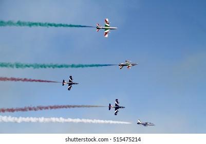 LIGNANO SABBIADORO, ITALY - AUGUST 14, 2016: performance of Frecce Tricolori, Italian jets aerobatic team, in front of a beach