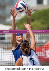 Lignano Sabbiadoro, Italy, July 20 2019 Muro di Serena Ortolani (Saugella Team Monza) su sciacciata di Claudia Provaroni (P2P Smilers Baronissi) during the Beach Volley Summer Tour - Lignano Sabbiador