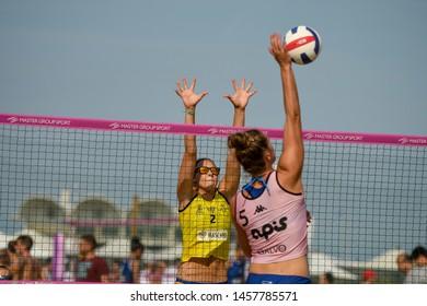 Lignano Sabbiadoro, Italy, July 20 2019 Schiacciata di Giulia Angelina (VBC APIS Casalmaggiore) murata da Alice Pamio (Agricola Zambelli Millennium Brescia) during the Beach Volley Summer Tour - Ligna