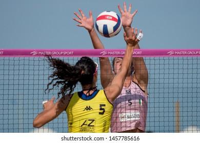 Lignano Sabbiadoro, Italy, July 20 2019 Giulia Angelina (VBC APIS Casalmaggiore) mura Alice Pamio (Agricola Zambelli Millennium Brescia) during the Beach Volley Summer Tour - Lignano Sabbiadoro - Fase
