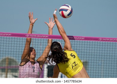 Lignano Sabbiadoro, Italy, July 20 2019 Muro di Valentina Zago (VBC APIS Casalmaggiore) su schiacciata di Silvia Fondriest (Agricola Zambelli Millennium Brescia) during the Beach Volley Summer Tour -