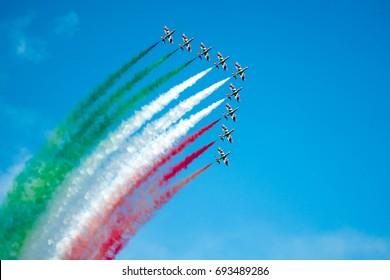LIGNANO SABBIADORO, ITALY, JULY 2017. Frecce Tricolori airshow. The italian acrobatic aviation team design the italian flag in the sky.
