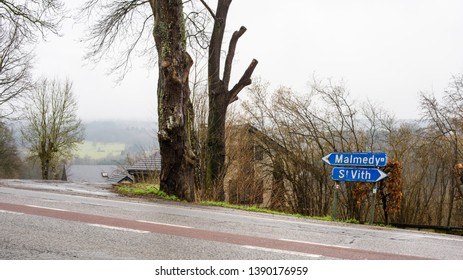 Ligneville, Malmedy, Belgium - March 7, 2017: The road sign on Grand Rue pointing each way directions to Malmedy and St Vith