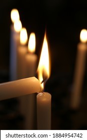 Ligthing one candle with another