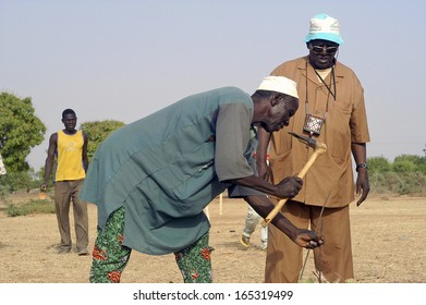 LIGUIDIMALGEM,  BURKINA FASO - FEBRUARY 20:  The dowser has determined that a particular drill the well developed, a villager is a pole tracking, February 20, 2007