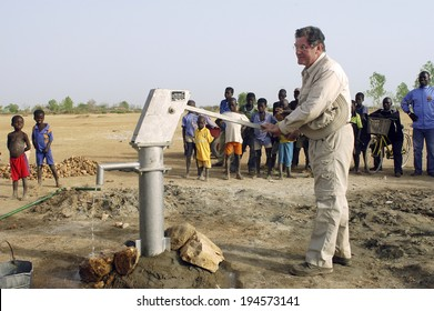 LIGUIDIMALGEM, BURKINA FASO - FEBRUARY 27: installation of a pump in Burkina Faso funded humanitarian associassion. An official of the association is happy, the water is there, February 27, 2007