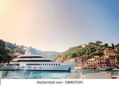 Liguria, Italy, Europe. The beautiful Portofino with colorful houses and villas, luxury yachts and boats in little bay harbor. Liguria, Italy, Europe.