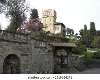 LIGURIA, ITALY, July 2018: touristic trip. Travel view of town Rapallo featuring Rapallo castle gate mansion. The image location is Rapallo in Liguria, Italy.