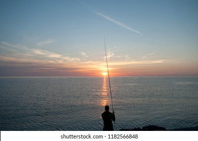 Ligurian fisherman at dawn in Laigueglia