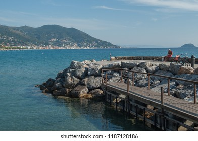 Ligurian pier with calm sea