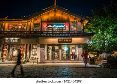 LIJIANG, CHINA - April 22,2019: Exterior of a Starbucks Coffee and Pizza Hut retail store in Lijiang old town.