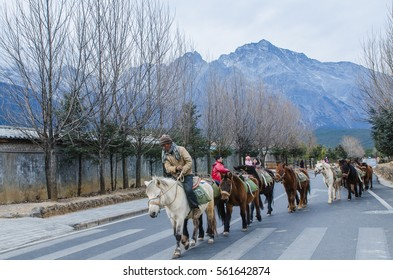 LIJIANG, CHINA - JAN 3: The horse ride control of horses in Jade Dragon Snow Mountain. which is the valley is the most beautiful of China.  on  Jan 3, 2017