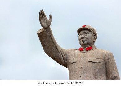 LIJIANG, CHINA, MARCH 8, 2012: Statue of Mao Zedong in central Lijiang. The city is famous for its UNESCO Heritage Site, the Old Town of Lijiang.