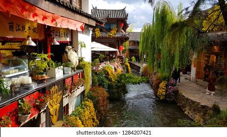 Lijiang, China - November, 2018. A view of Lijiang with a canal. Lijiang, Yunnan, China