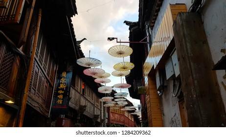 Lijiang, China - November, 2018. A view of Lijiang with umbrella-shaped decorations. Lijiang, Yunnan, China
