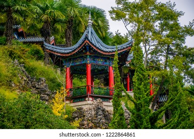 """Lijiang, China - Oct 2018: Chinese arbor it is traditional Chinese architecture. Mu's Residence (Mufu Mansion). Located in Old Town of Lijiang, Yunnan Province, China. Translation is """"Arbor of Peace""""."""