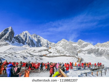 Lijiang City, Yunnan Province, China – May 27, 2018: People travel to the summit of the snow-capped mountains on holidays and they climb the top of a snow-capped mountaintop.