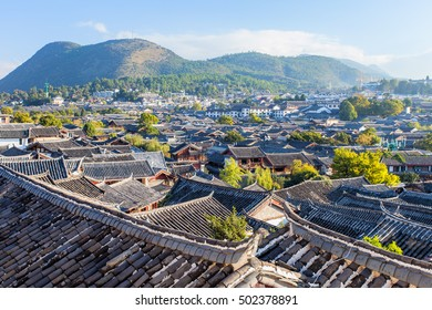 Lijiang Old Town building roof in China at the morning