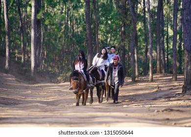 Lijiang, Yunnan, China - 19 Jan 2019: Tourist riding on horse to travel at the ancient Tea Horse Road.