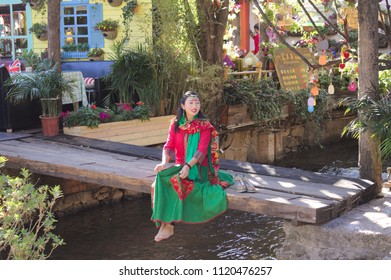 Lijiang, Yunnan, China - 29 December 2017: Chinese model with traditional clothes