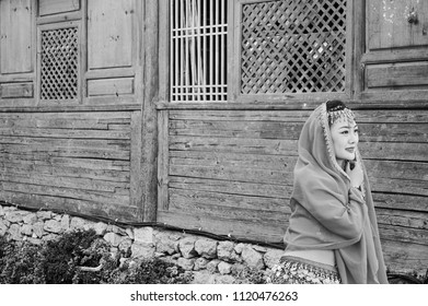 Lijiang, Yunnan, China - 29 December 2017: Isolated chinese model and wooden background