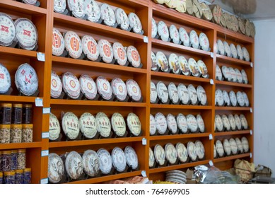 LIJIANG, YUNNAN, CHINA-OCTOBER 23, 2017 : Rows of Chinese puerh tea on display. Pu erh tea originated from Yunnan highland area.